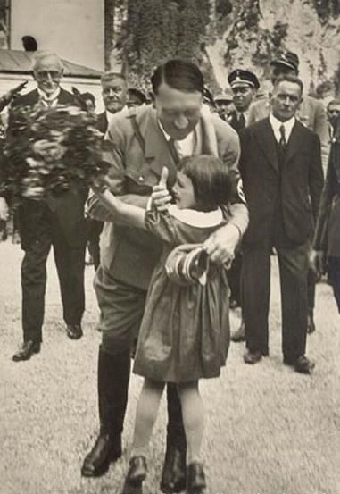 Adolf Hitler hugging girl
