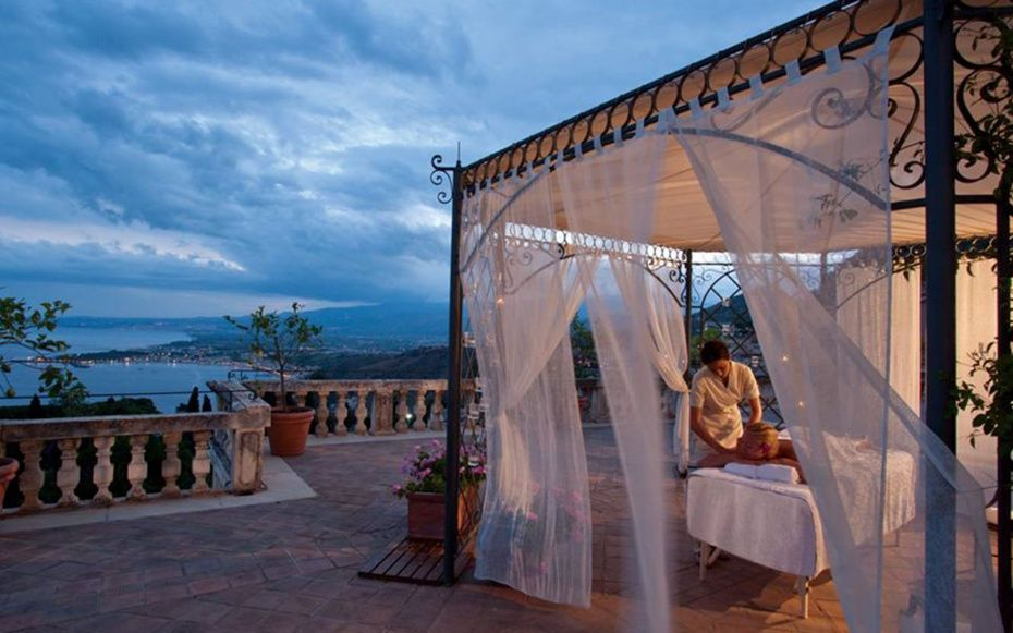 Perched high in the rocky hills of Taormina at the foot of the ancient Greek Theater, the Belmond Grand Hotel Timeo is an icon of storied nobility and Italian glamour.