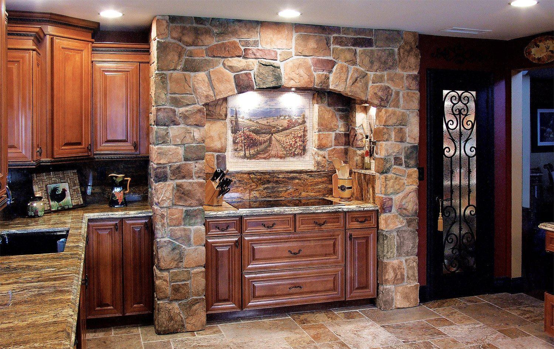 Flat stove top, natural stone surround, wood cabinets, luxury granite