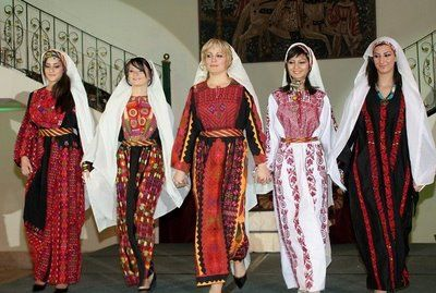 Traditional clothing from the community to make the banner.