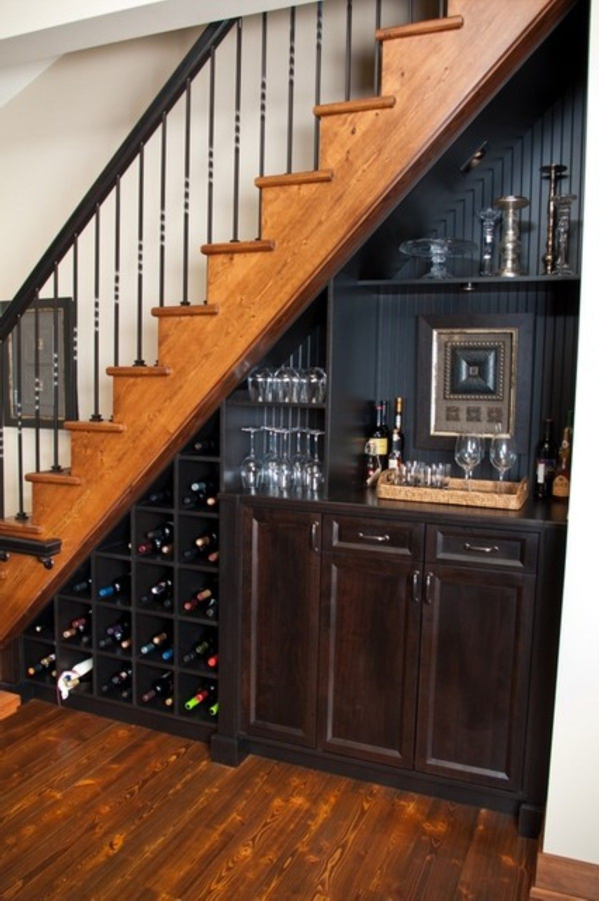 Maximizing limited space in awesome way with mini bar under stairs