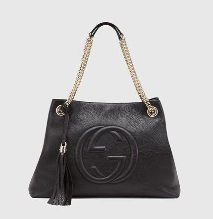ca4a27f7650 Gucci - Sac à épaule soho de taille moyenne en cuir rose clair avec  bandoulières en chaîne 308982A7M0G1000