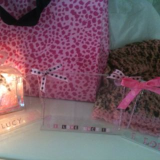 Dollar picture frames with bows and glitter letters and stickers added. 2 for the mama-to-be and one for grandma.