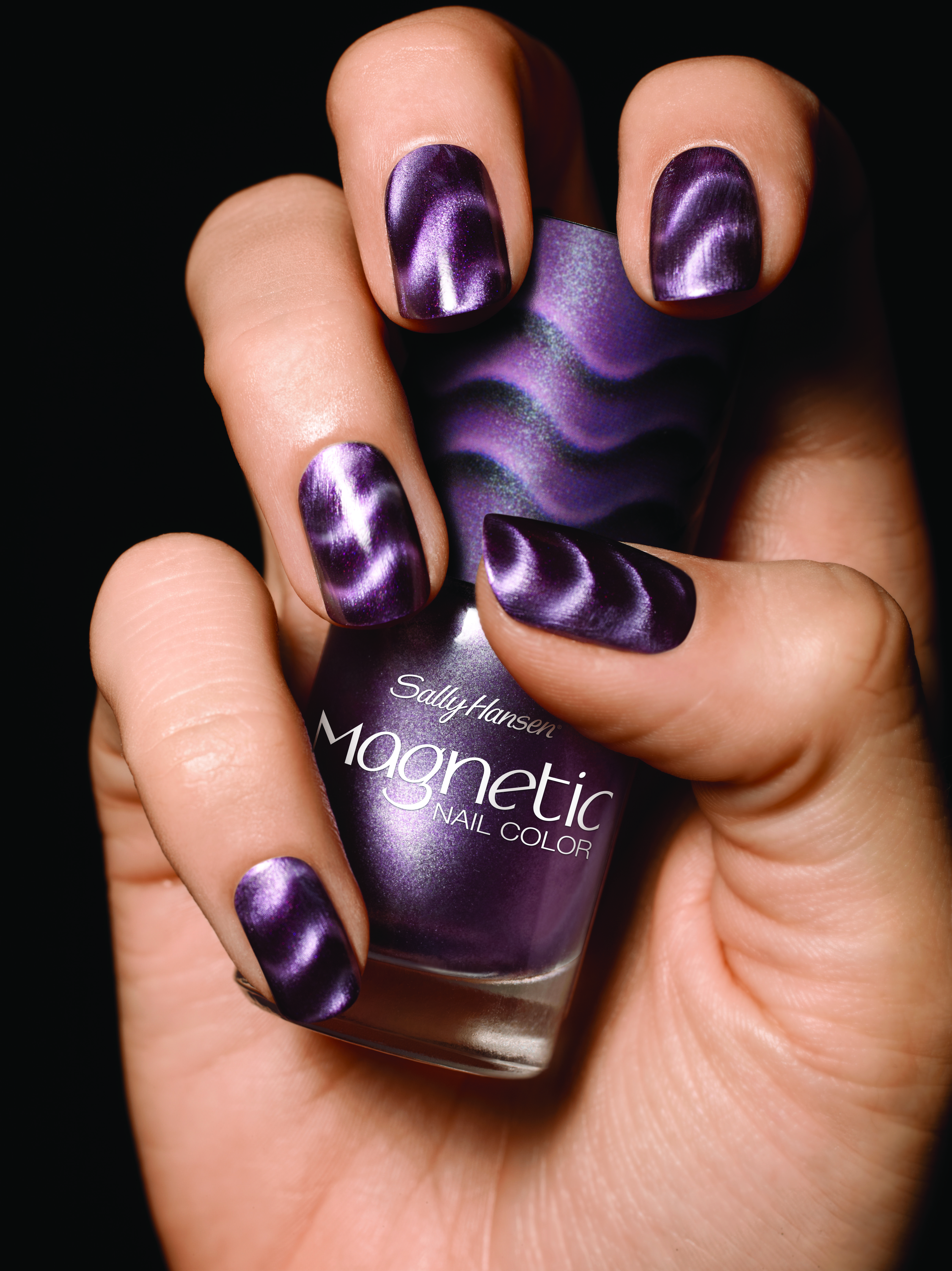 Sally Hansen Magnetic nails. I have the pink checkerboard one that I ...