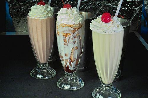 Milkshakes with cherries.