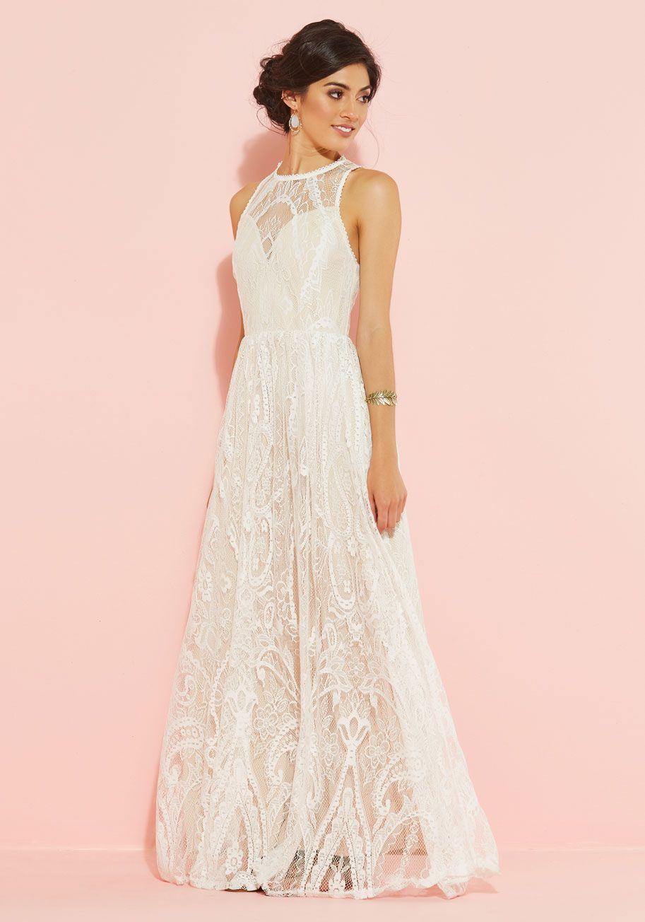 be7ef644ce Draped in the dreamy white lace of this maxi dress