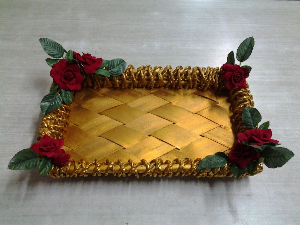 Small cane tray with artificial flowers decorations and the tray is small cane tray with artificial flowers decorations and the tray is painted in gold colour junglespirit Choice Image