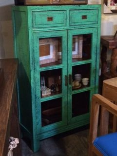 Love this distressed painted cabinet!