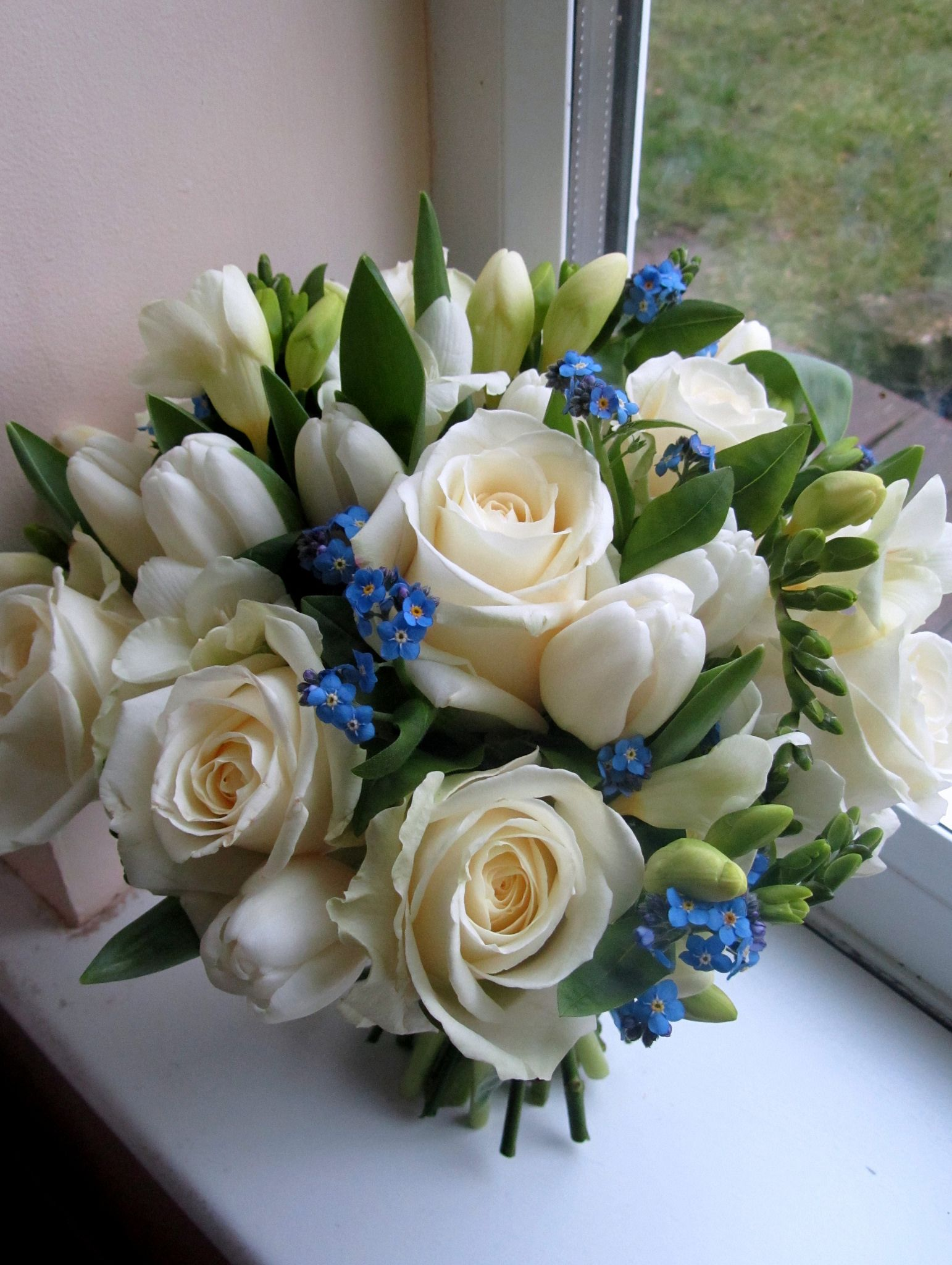 Blue and white bouquet white bouquets white roses and florists httpsflicprohvph blue and white bouquet bouquet of white roses tulips and forget me nots by the flowersmiths wedding florist in kent izmirmasajfo