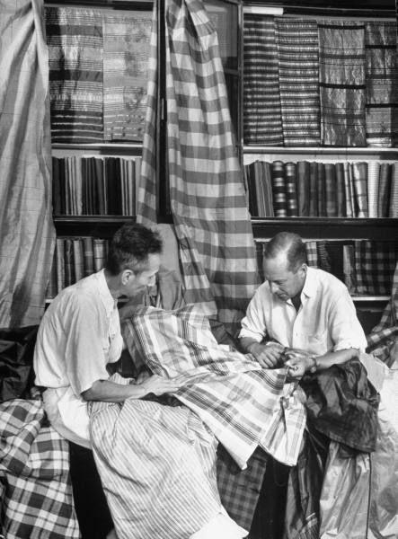 Jim Thompson inspecting silk at La One Shop {BKK} 1950
