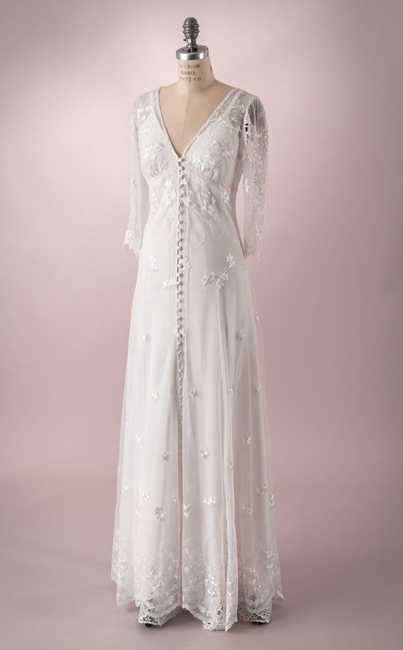 Wedding Gown Of Embroidered Tulle With Buttons Up The Front And Full Length  Sleeves. Backyard