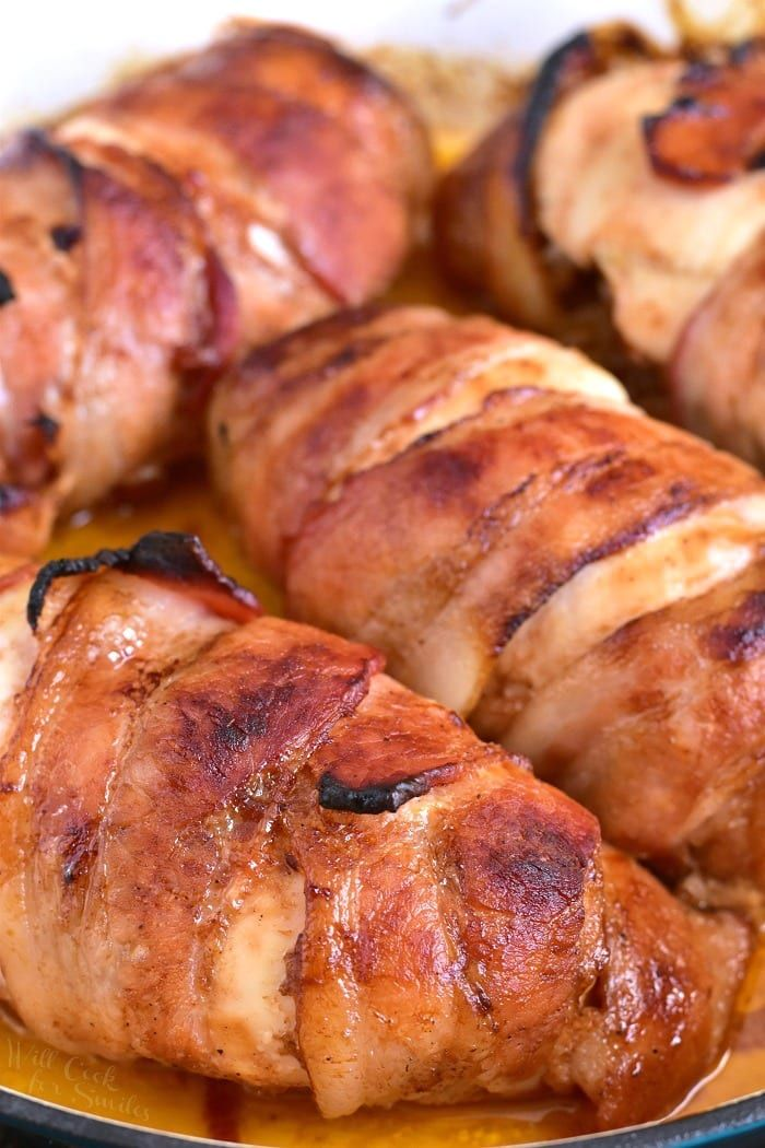Bacon Wrapped BBQ Stuffed Chicken Breasts recipe. Only 4 ingredients to created this delicious chicken dinner. Inside, this chicken is stuffed with a mixture of onions sauteed with bacon and BBQ sauce and outside, the chicken is slathered with more BBQ sauce and wrapped in bacon.