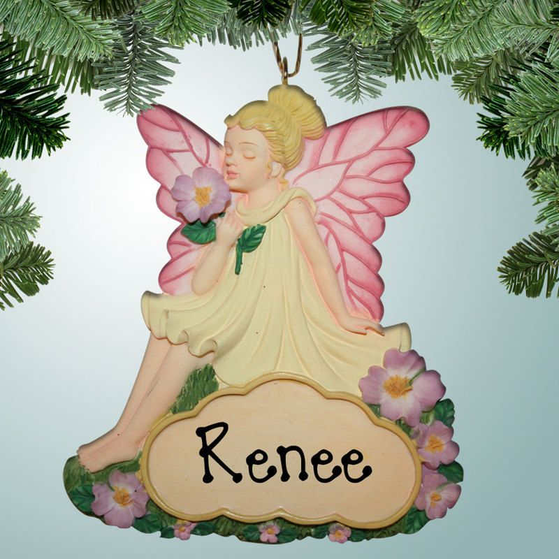 """PersonalizedFree.com - Fairy with Flowers Personalized Ornament / Magnet, $10.50 -- There is nothing more beautiful than a fairy with wings! In fact you probably have a little fairy in your family that is so pretty that you'll need to find a place for her ornament for the entire year. With the magnet on the back of this one, she can stick to the fridge to monitor you all year long!  3.5"""" tall x 3.25"""" wide. Made from resin (http://personalizedfree.com/fairy-with-flowers-ornament-magnet/)"""