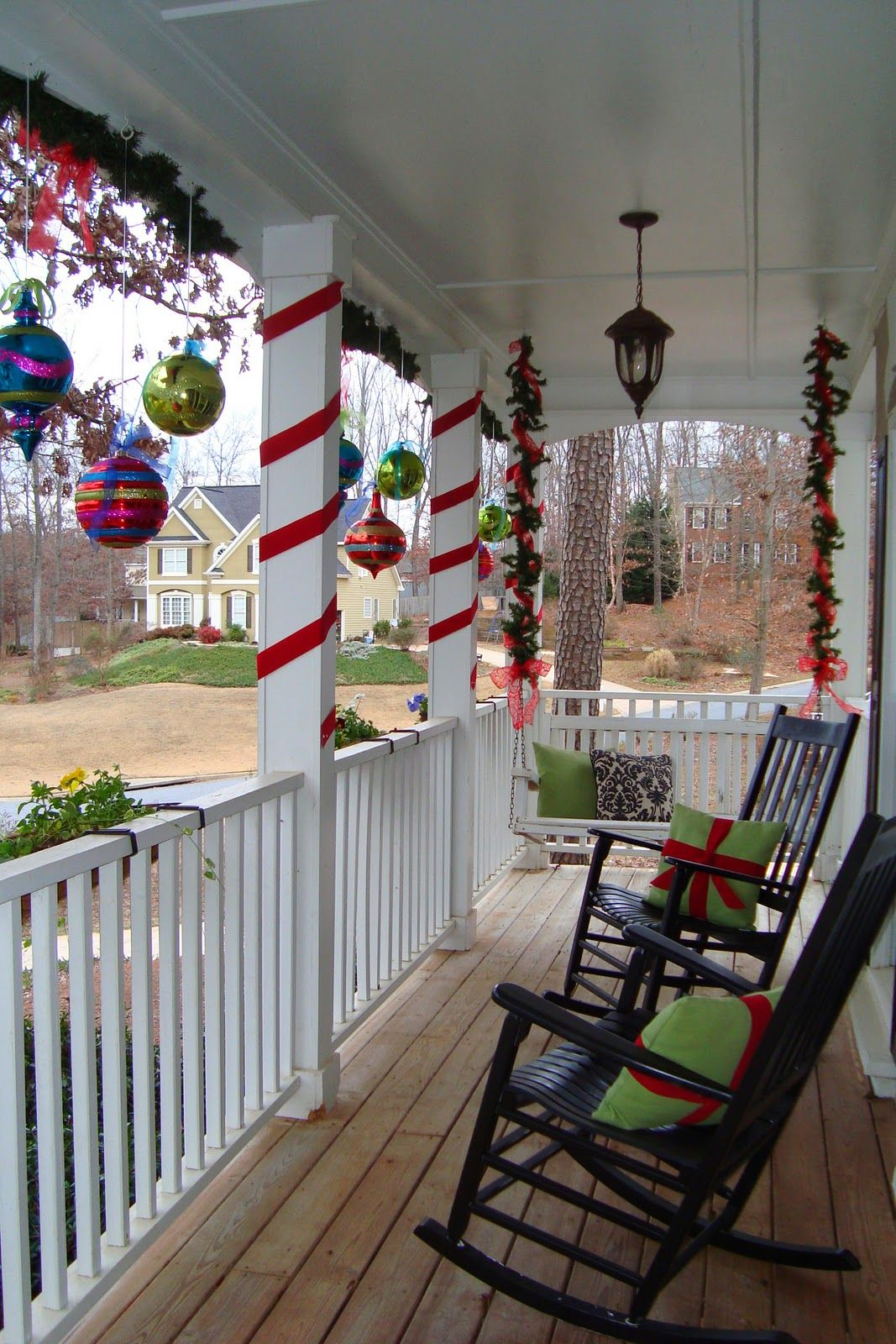Ribbon Wrapped Around Pillars And Ornaments From The Ceiling Christmas Porch Decor Outside Christmas Decorations Front Porch Christmas Decor