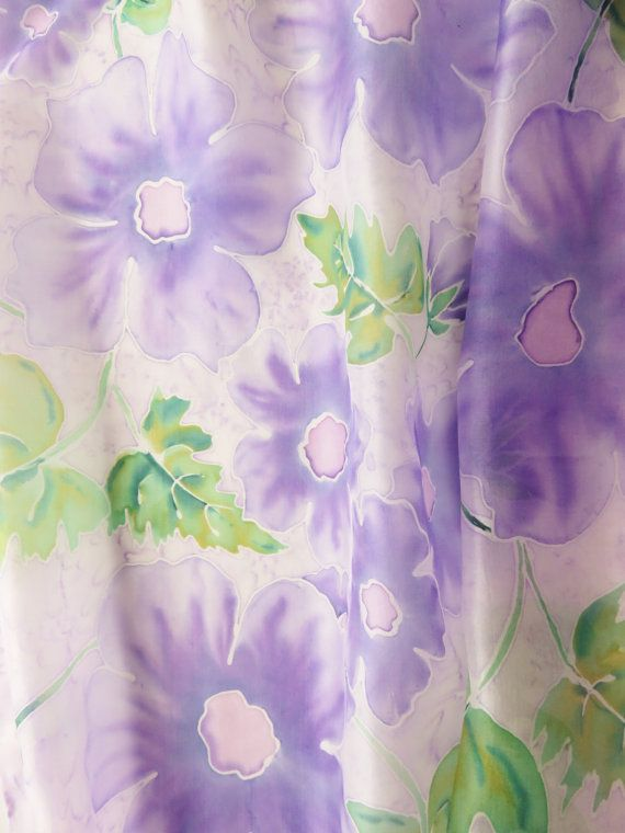 Purple silk scarf hand painted with darker purple flowers and green leaves.  The scarf is ponge 5 100% pure silk and measures approximately 14 x 71 or 35 x 180cm. It has been painted with iron fix silk paints.  My scarves are pieces of wearable art and have therefore been signed with a small initialled monogram in one corner.  Washing instructions: hand wash in warm water with mild detergent. Iron while still damp with medium iron.  All items in my shop have been hand painted by me and are…