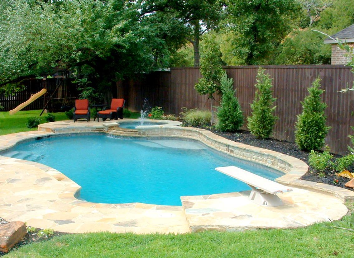 Large backyard pools with diving boards freeform for Big outdoor pool