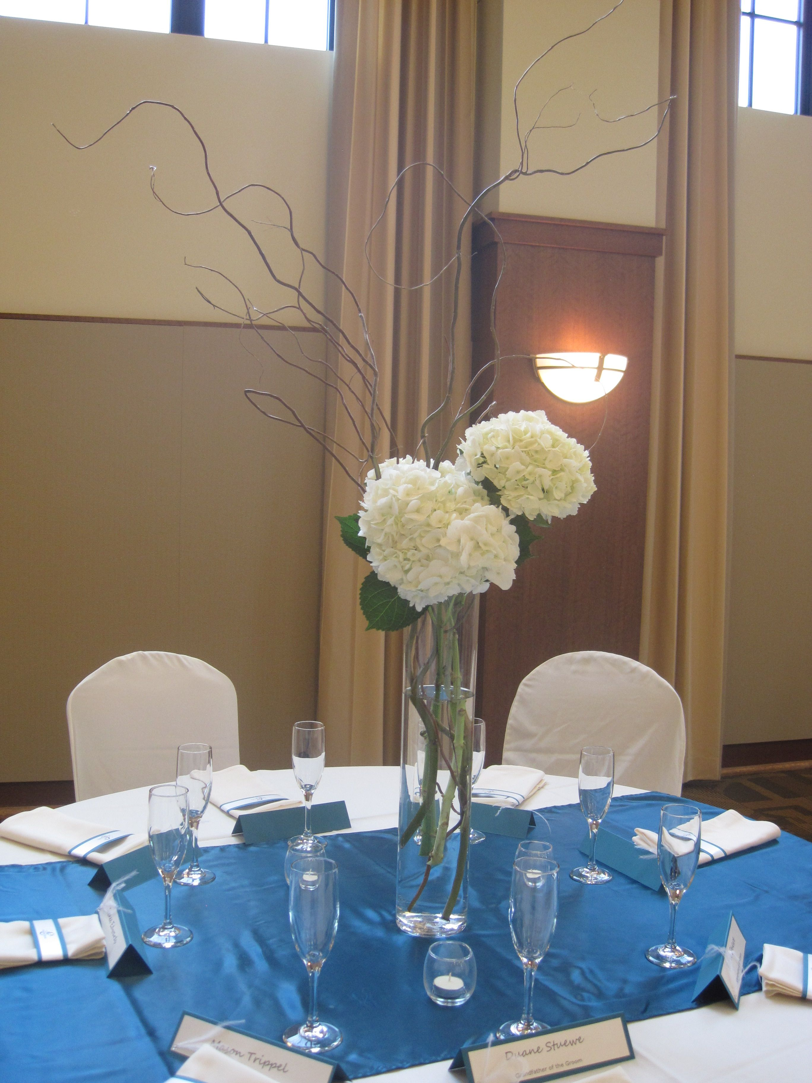Tall wedding centerpieces teal runner hydrangea branch