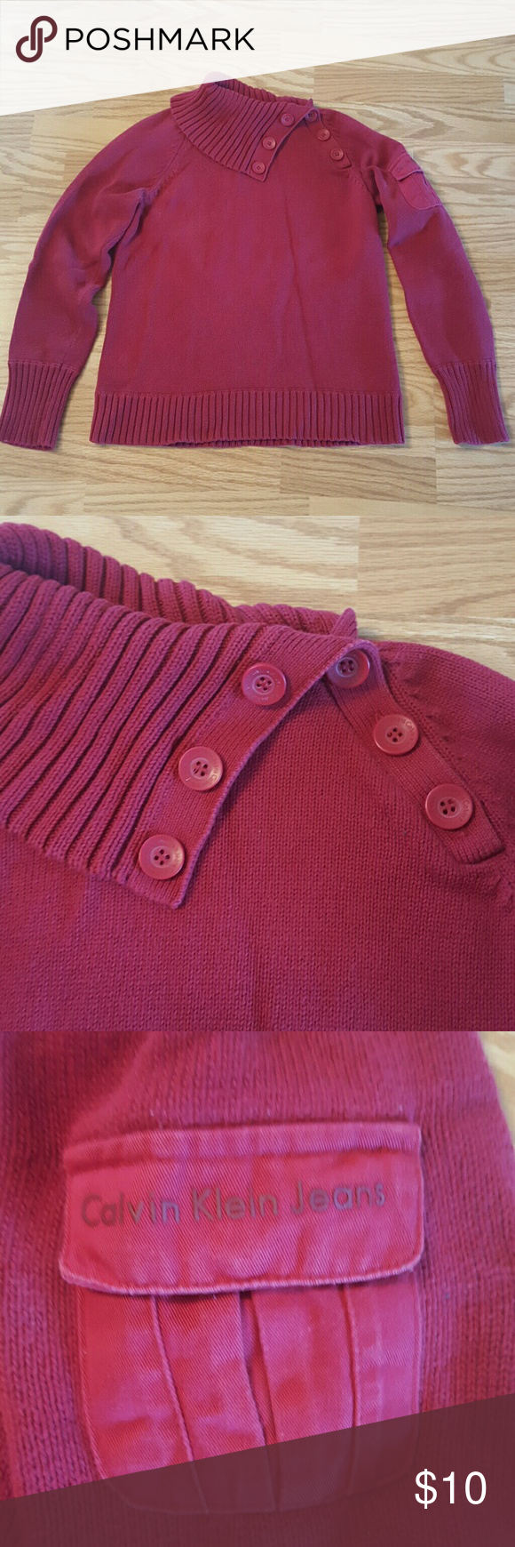 Calvin Klein Cowl Neck Sweater This super cute sweater is in good used condition!! It's Cowl necked and has decorative buttons along Cowl and shoulder!! It also has a cute pocket on the upper left arm! Calvin Klein Jeans Sweaters Cowl & Turtlenecks