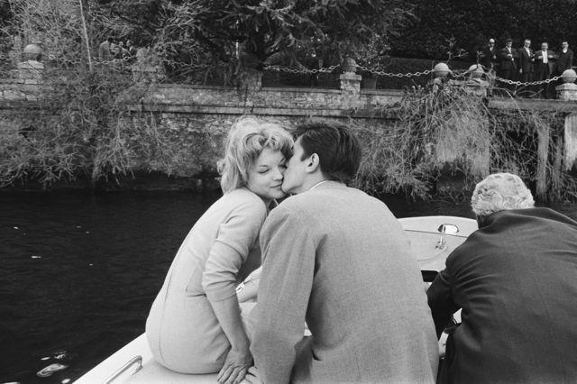 romyschneider:  Romy Schneider & Alain Delon celebrating their engagement in Lugano, 1959.