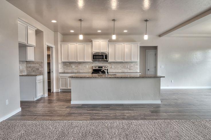 Huge Kitchen With Merillat   Spring Valley, Maple, Cotton Cabinets, Wood  Corbels Under The Raised Breakfast Bar, Woodland Maple Wood Laminate  Flooring, ...