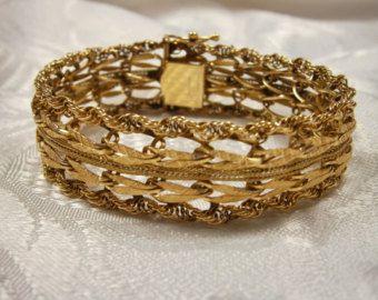 14kt Gold Wide Bracelet Five Rows Of Design Rope Edge