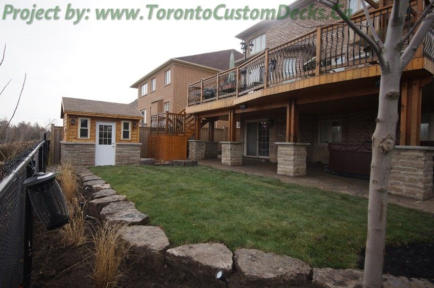 big stones lined the edge to prevent soil from being eroded during heavy rains   toronto  deck