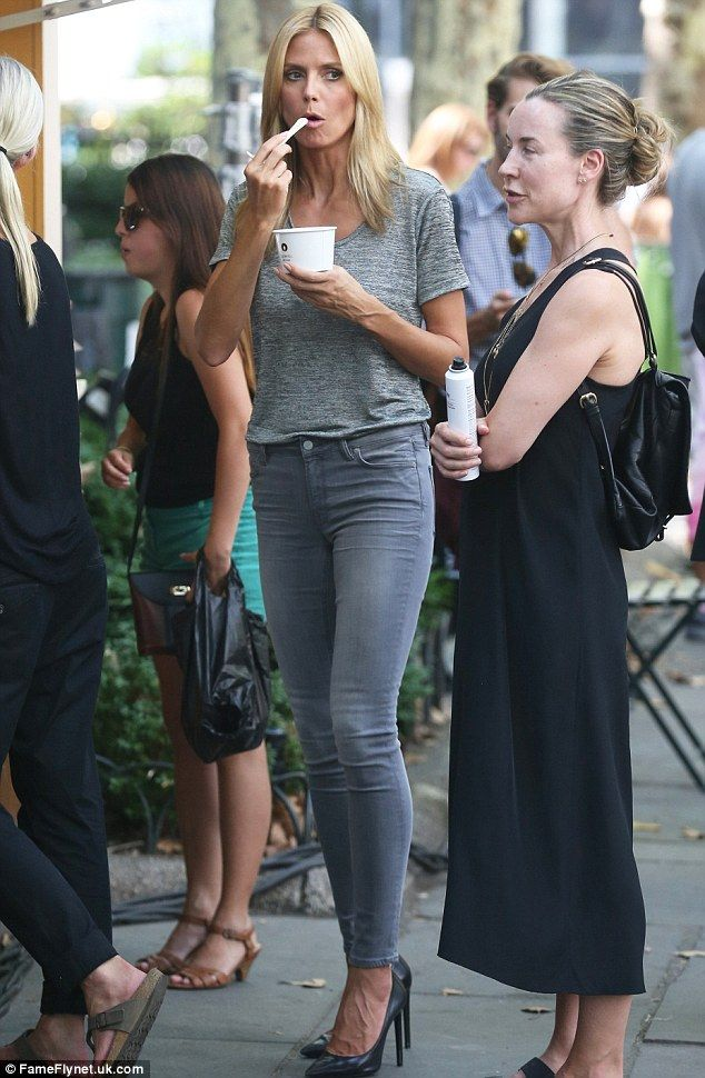 That's not fair! Heidi Klum stuffs her face with ice cream as she shows off her slender ph...