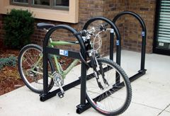 Rail-Mount Bike Rack - The CycleSafe rail-mount bike rack is a portable, multi-bike parking unit that allows for removal of the racks for snow plow or seasonal use. The rail-mount bike rack can also function as a bike corral, providing an opportunity to promote bike accessibility to local businesses and to enhance street and neighborhood life.