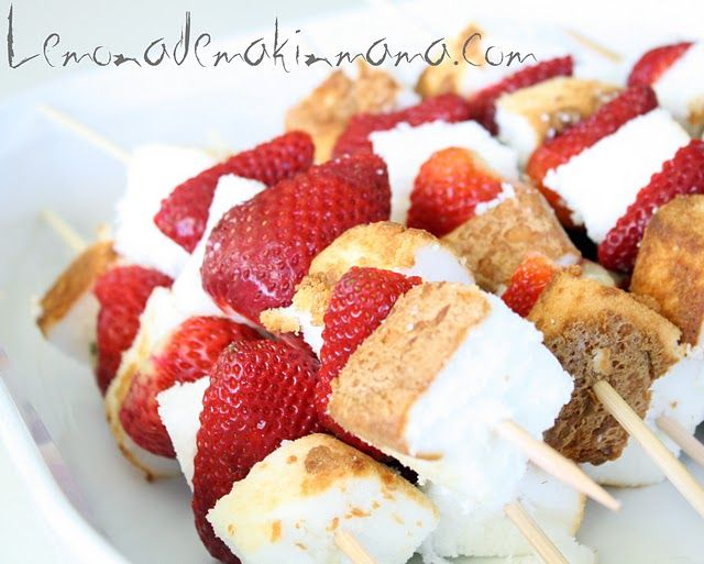 Strawberry Shortcake on a stick. Strawberries and angel food cake. Freeze cake to make it easier to cut.