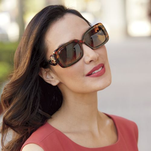 Scroll Arm Sunglasses from Monroe and Main. Take a twirl in swirl-framed shades that catch eyes with their unique design. Large frames add a hint of mystery.