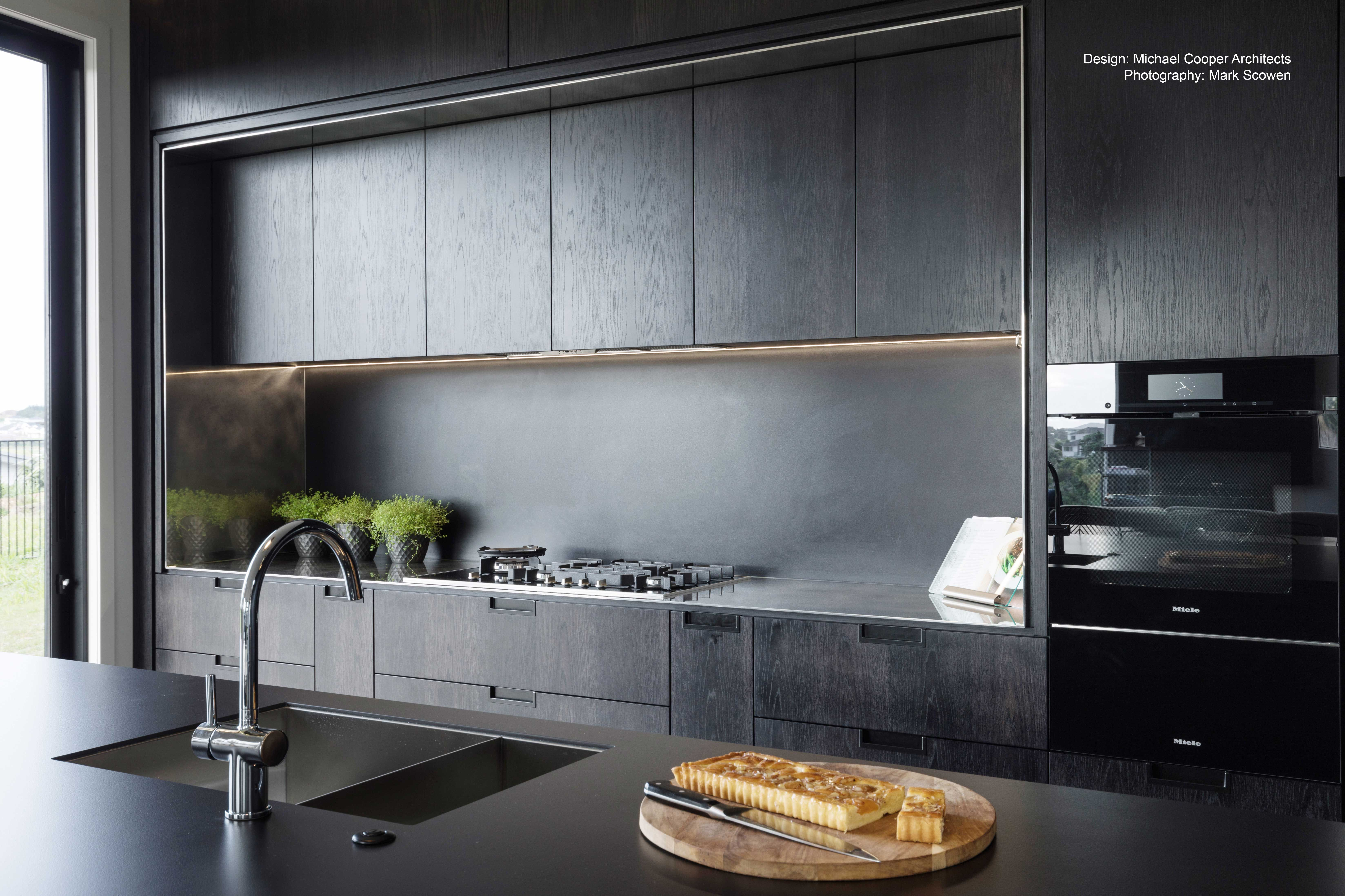 Matt Black Cabinetry And Splashback Create Chic Dark Kitchen ...