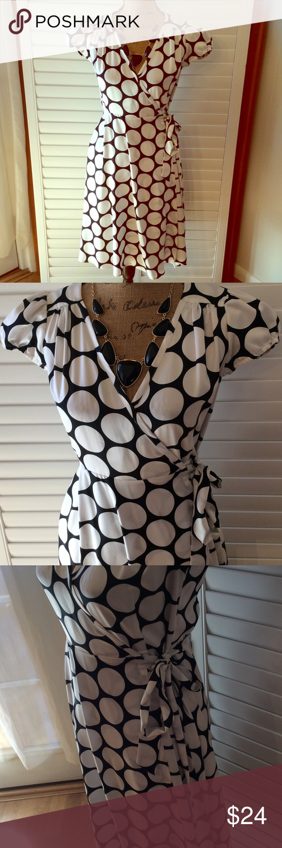 "Polka Dot Banana Republic Dress Cute dress by Banana Republic. Size 2. Black and white. Polyester. Wrap dress. Length is 41"" waist is adjustable and so is bust. Dresses Midi"