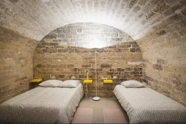Best Parisian Airbnbs Stone Cave Bedroom