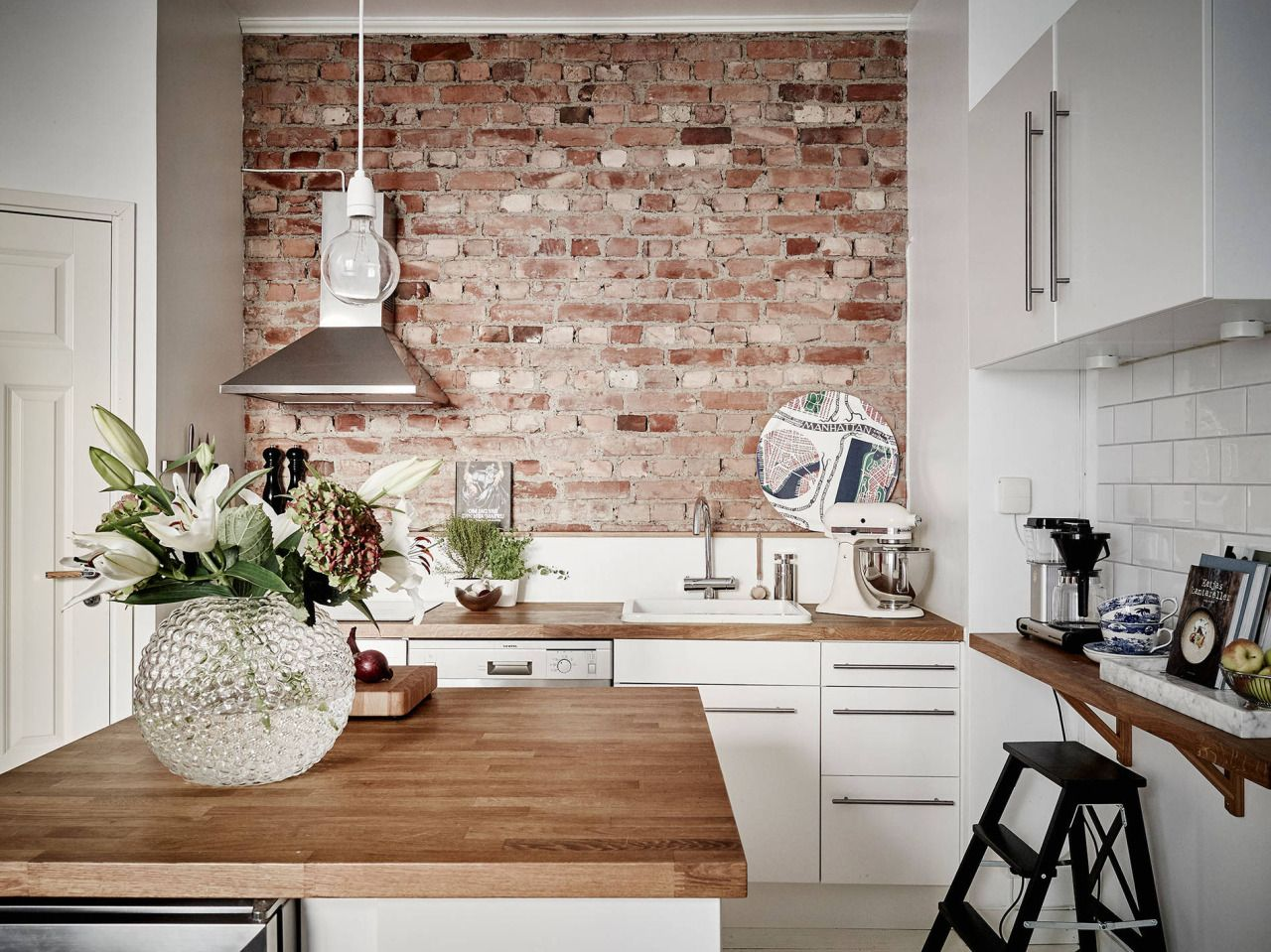 banquette backs up to island exposed brick kitchen from VT interiors:
