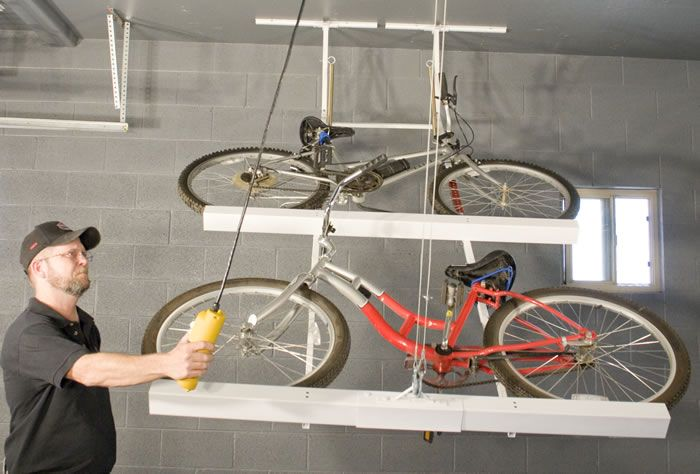 Motorized Bicycle Storage Rack That Folds Flush With Ceiling