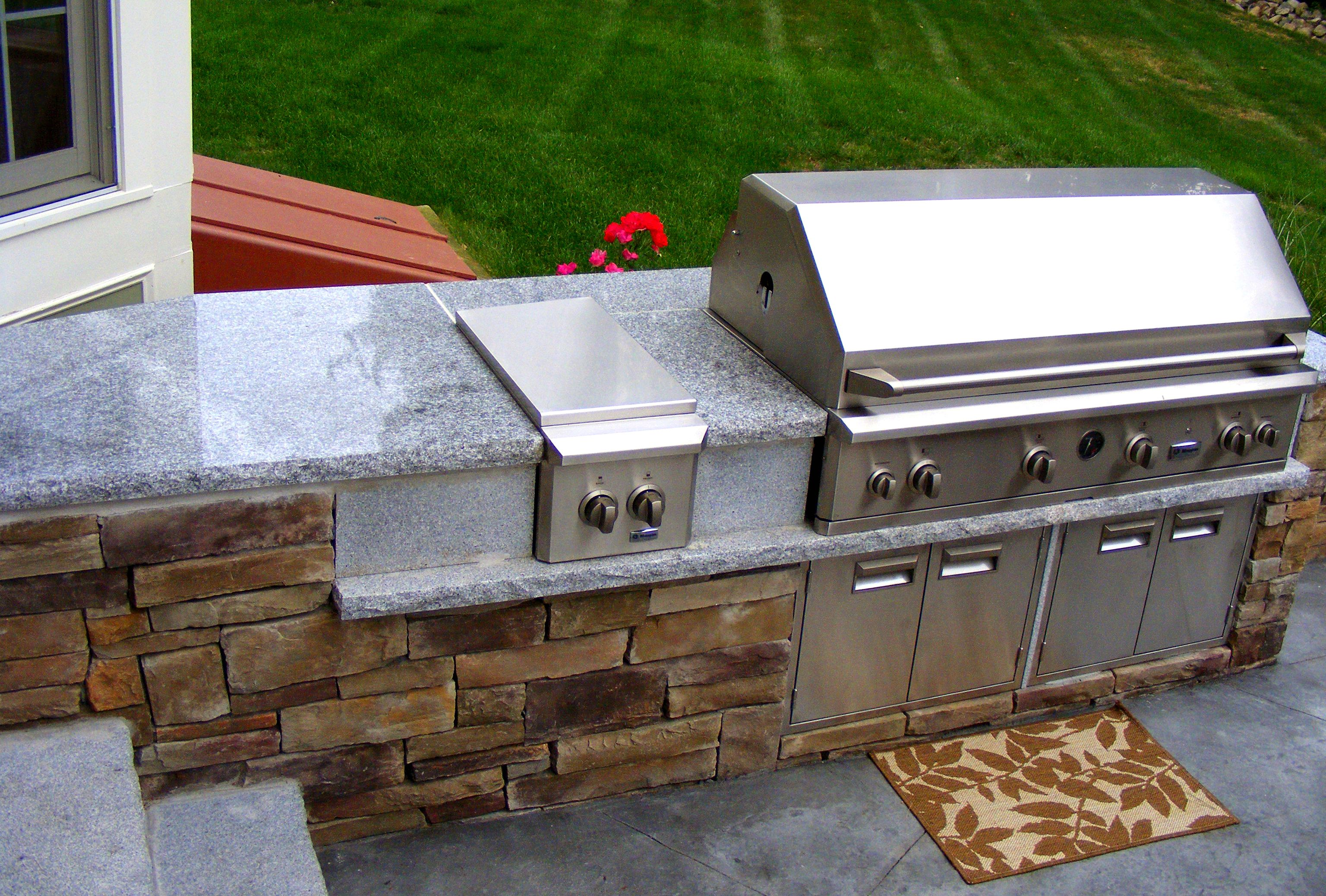 outdoor kitchen a compilation of natural stone and granite were used to create this outdoor on outdoor kitchen natural id=95328