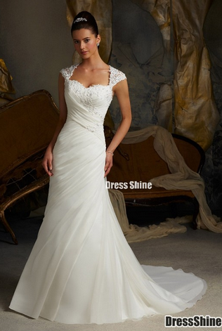I think I want a wedding dress with sleeves and this one would be perfect.