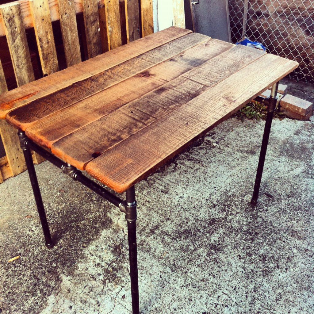 cast iron pipe desk with reclaimed wood top. i can totally diy
