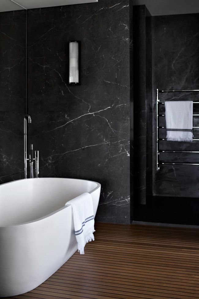 Gentil Luxurious Bathroom: Black Marble Wall And Cognac Hardwood Floor.