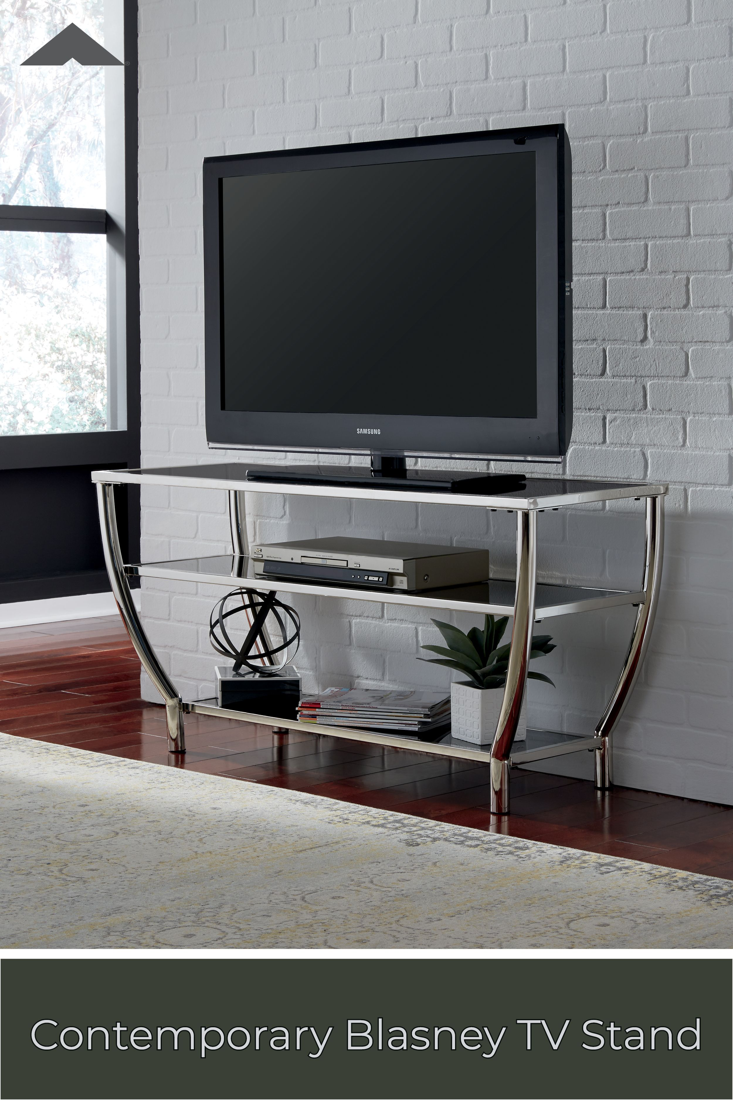 Blasney Black And Chrome Finish Tv Stand By Ashley Furniture Ashleyfurniture Livingroomdecor Livi Living Room Tv Stand Living Room Designs Glass Tv Stand
