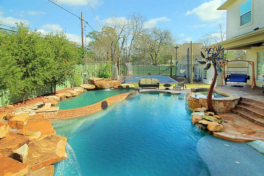 Super Sized Backyard With All The Trimmings Lagoon Style Pool Has Water Slide Grotto Fountains The Area To The Far R Pool Swimming Pools Luxury Real Estate