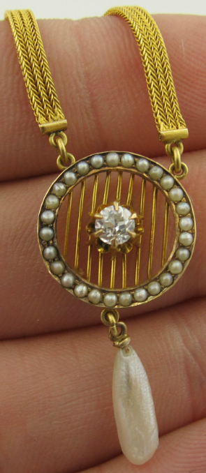 Edwardian woven 18k gold, seed pearl, and diamond lavalier. Via Diamonds in the Library.