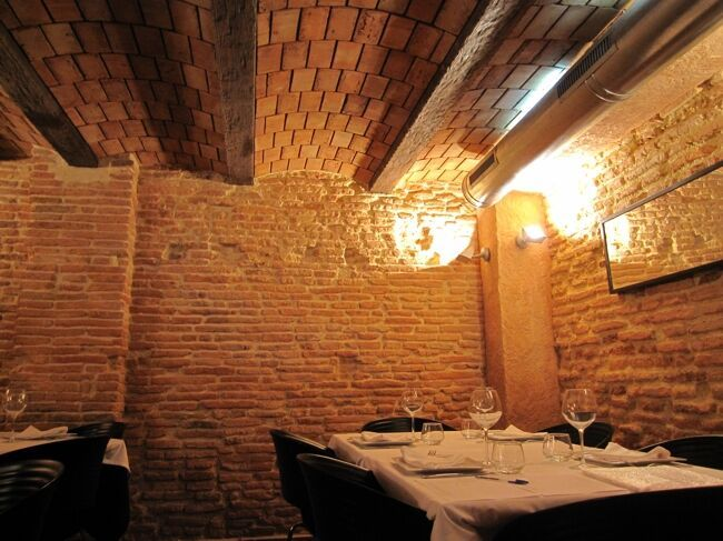 Revestimiento de ladrillo de piedra artificial en paredes for Revestimiento pared piedra artificial