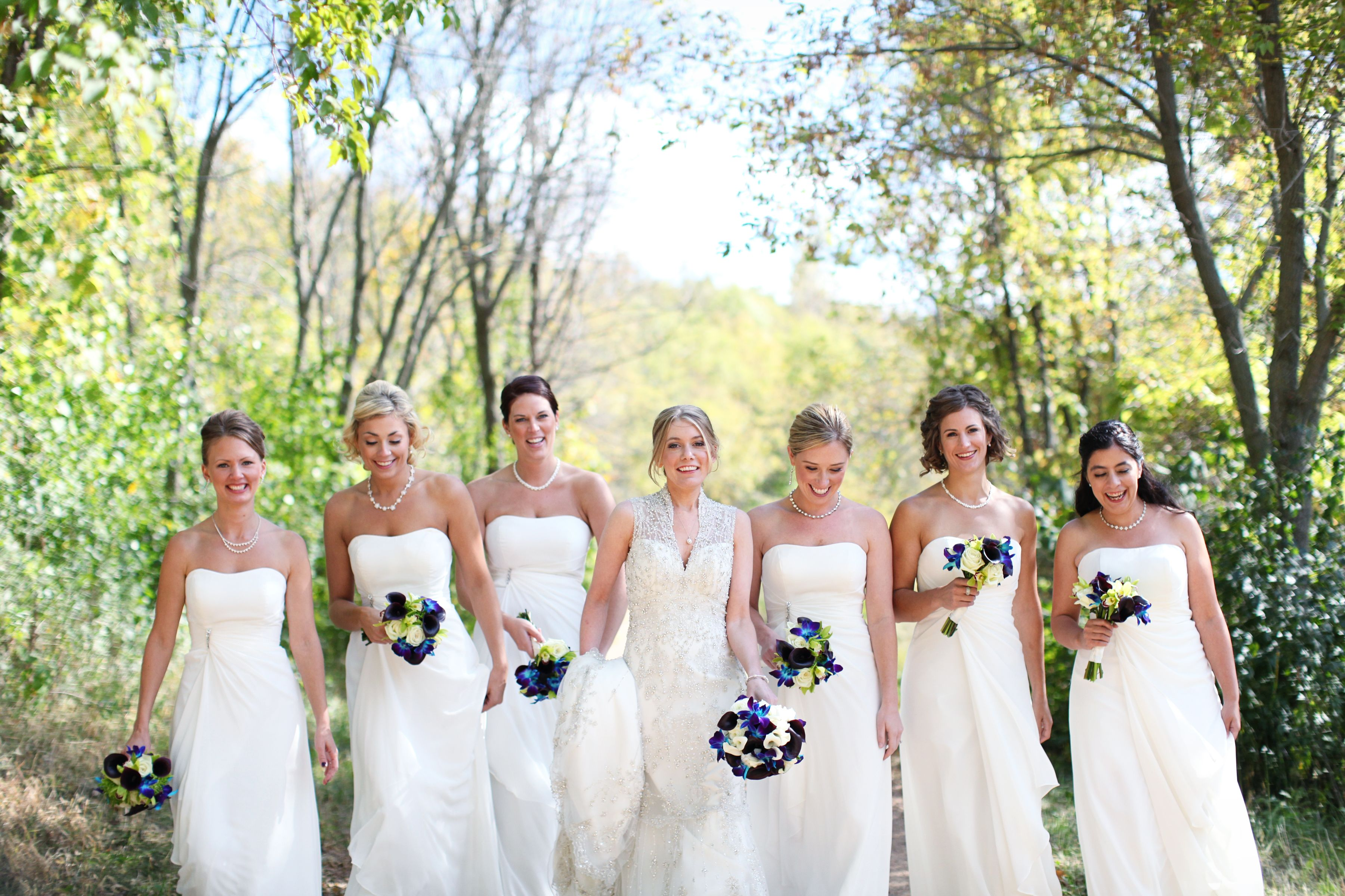 Cream bridesmaid dresses blue and purple bouquets accent green cream bridesmaid dresses blue and purple bouquets accent green in bouquet spring wedding ombrellifo Image collections