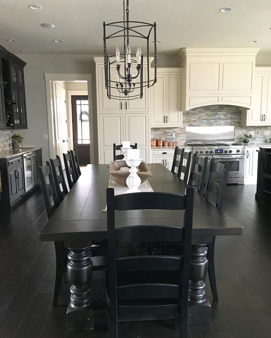 black and white modern farmhouse kitchen with long dining table
