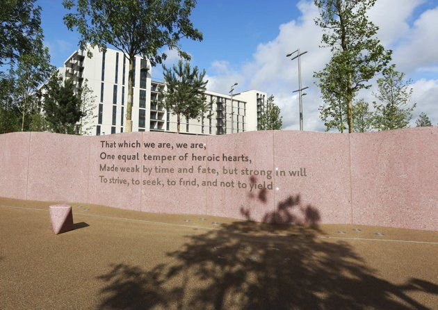 Words inscribed in the wall next to the Olympic Village Service Centre built for the London 2012 Olympic Games in Stratford, east London