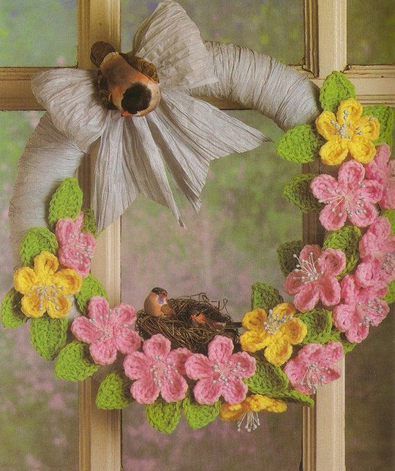 Pretty blossoms and a cheerful, bow-trimmed wreath make a cozy home for a family of sparrows. Display this bright and colorful accent in any room of your home for instant sunshine! Skill Level: Beginner Hook Size: E and G Material: Pink, green and yellow yarn, blue twisted paper, flower stamens, one fat Sparrow and two babies, ready-made bird nest, 12 foam wreath, spray starch Finishing Size: Each flower is 2 1/2 across ALSO INCLUDED: Extra file that includes the equivalent sizes for c...