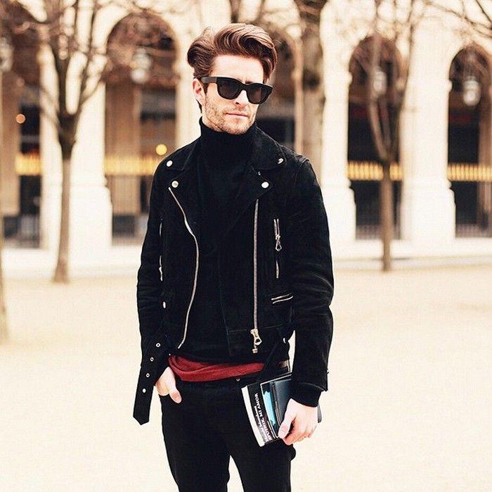 Pelayo Diaz in a black moto jacket and turtleneck during fashion week
