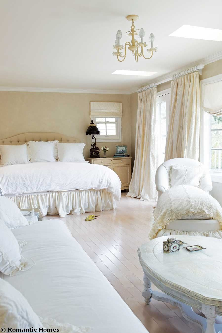 Romantic White Bedroom: Richly Appointed Bedding And Generous Window Treatments