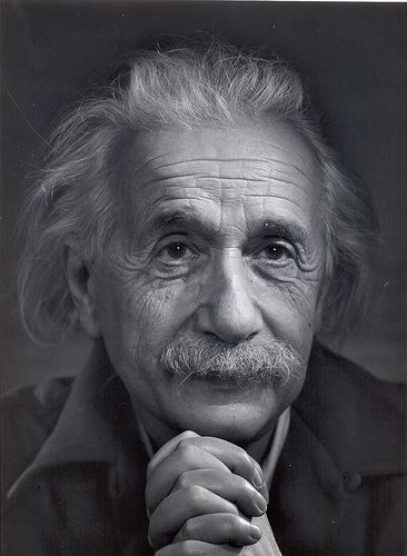 ALBERT EINSTEIN - I believe in Spinoza's God who reveals himself in the orderly harmony of what exists, not in a God who concerns himself with the fates and actions of human beings.